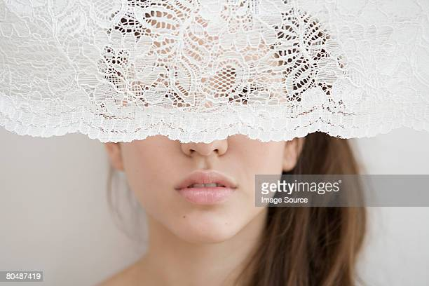 woman behind a net curtain - lace textile stock pictures, royalty-free photos & images