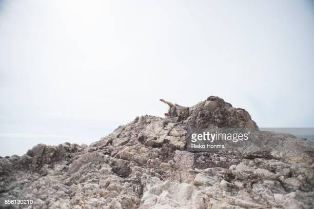 Woman behind a rock