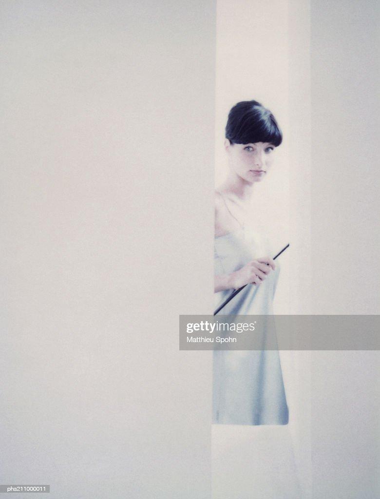 Woman behind a wall. : Stockfoto
