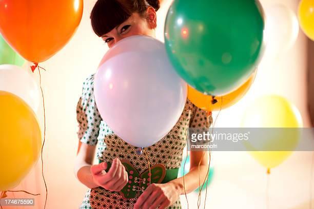 woman behind balloons - flying solo after party bildbanksfoton och bilder