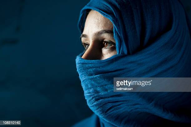 Woman Behind Blue Veil On Blue Background