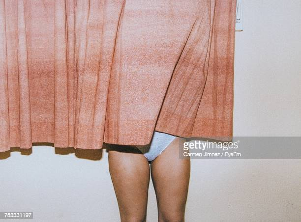 woman behind curtain - femmes en culottes photos et images de collection