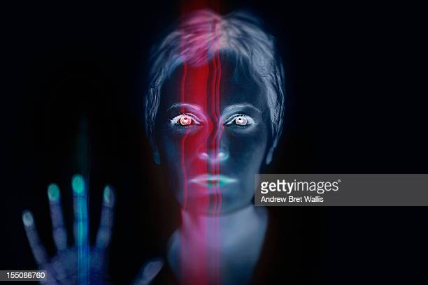 Woman behind finger and face recognition scanner