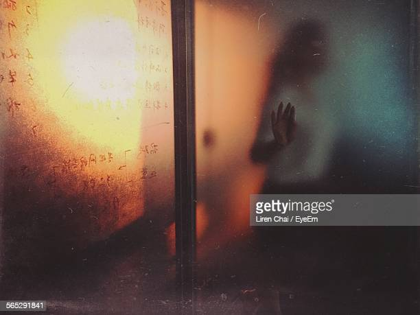 Woman Behind Glass Door In Shala Cafe And Bar
