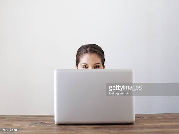 Woman behind laptop