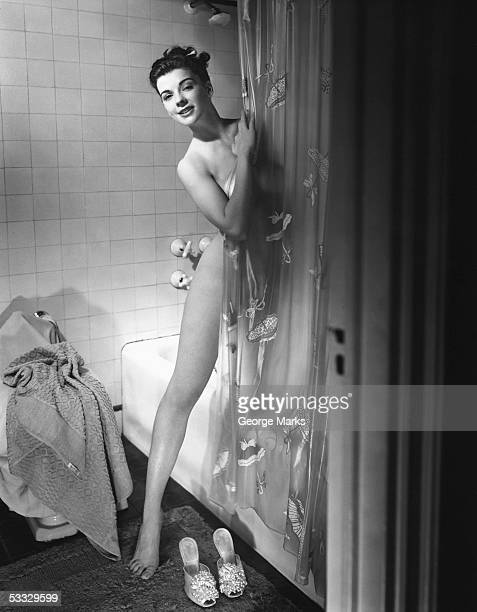 Woman behind shower curtain