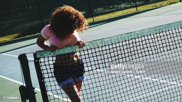 Woman Behind Tennis Net