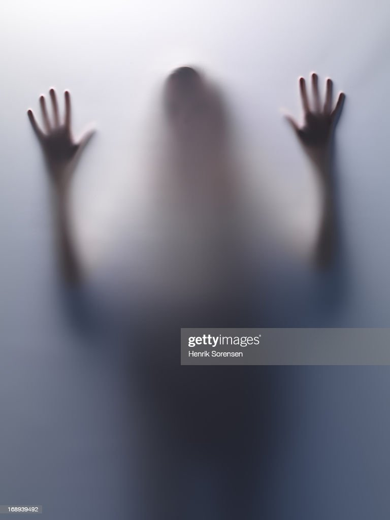 Woman behind translucent surface : Stock Photo