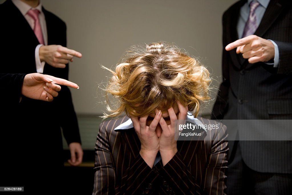 Woman Being Accused in Office : Stock Photo