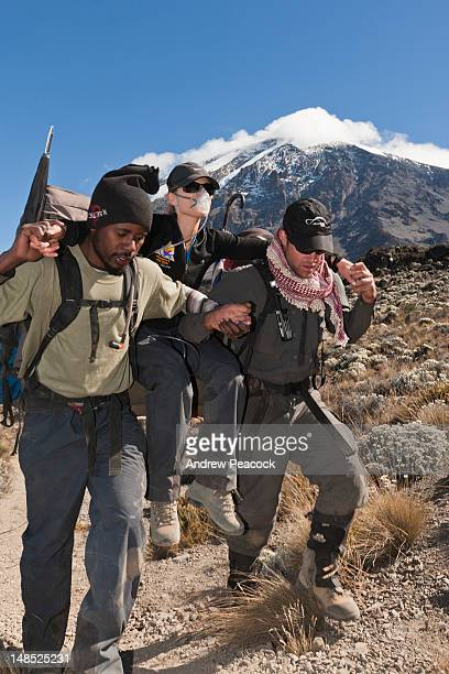Woman being carried down Mount Kilimanjaro on oxygen therapy for treatment of altitude illness Kilimanjaro National Park.