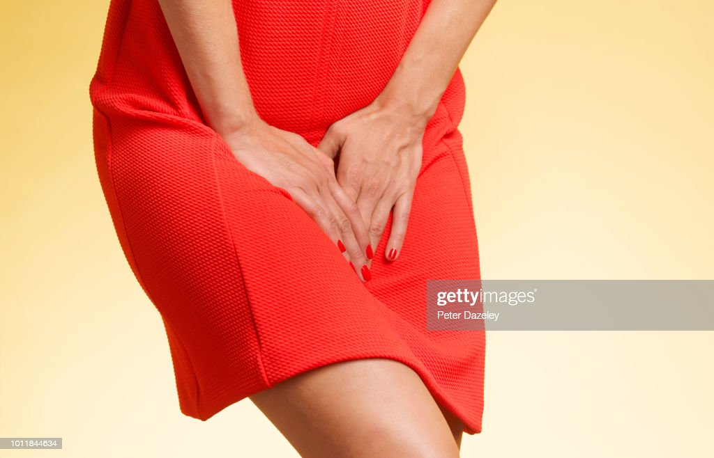woman being caught short for toilet : Stock Photo