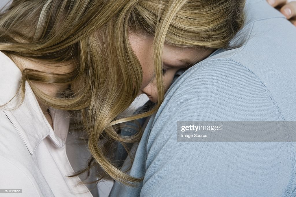 Woman being consoled : Stock Photo