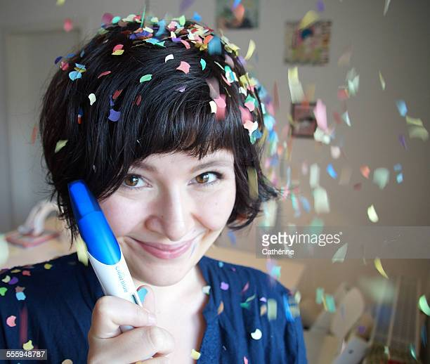 Woman being happy about positive pregnancy test
