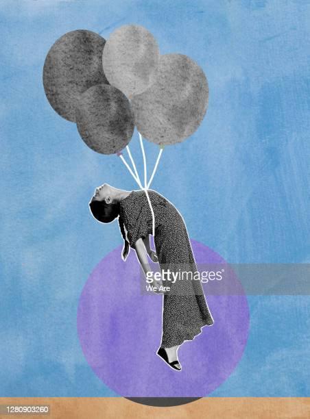 woman being held up by balloons - compuesto digital fotografías e imágenes de stock