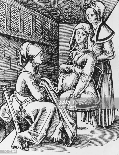A woman being helped to give birth on a birth chair by two midwives circa 1513 Original publication 'Der Rosengarten' by German physician Eucharius...