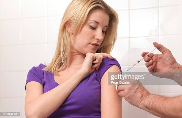 Woman being inoculated