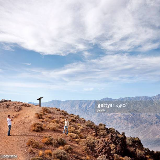 Woman being photographed by man at Dantes View