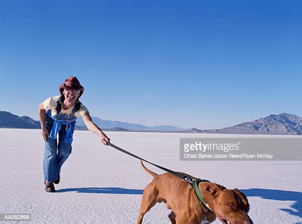 Woman being pulled by dog, Bonneville Salt Flats, Utah, USA