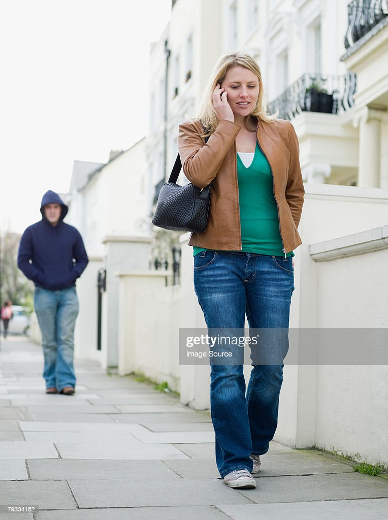 A woman being stalked : Stock Photo