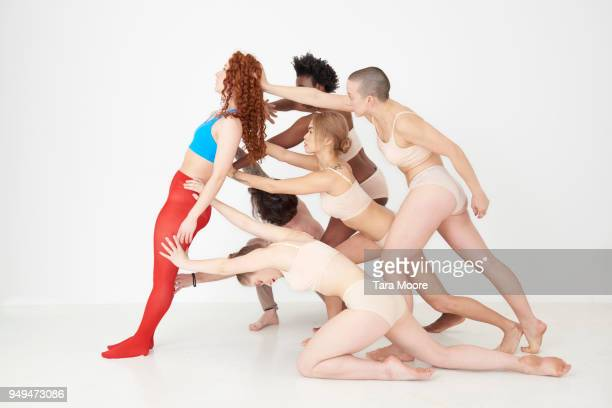 woman being supported by group of people