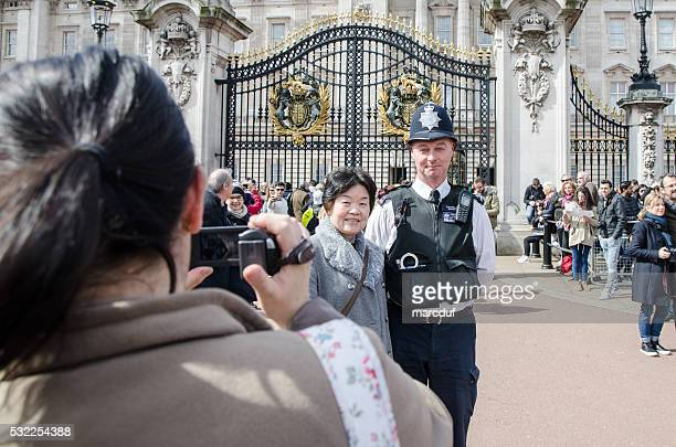Woman being taken in picture with policeman