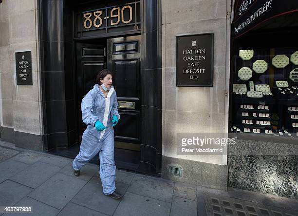 Woman believed to be a police forensics officer emerges from a Hatton Garden safe deposit centre on April 7, 2015 in London, England. Police are...