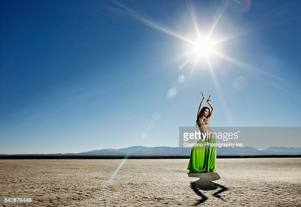 woman belly dancing in desert - belly dancing stock photos and pictures