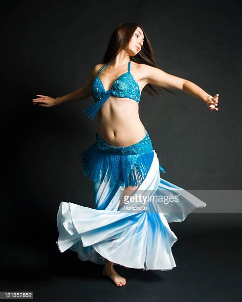 woman belly dancing - belly dancing stock photos and pictures