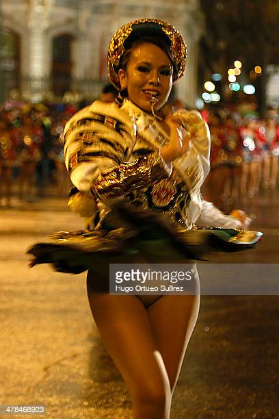 Woman belonging to the Bolivian Community performs a traditional dance during the inaugural parade of the Madrid Carnival. Thousands of people...