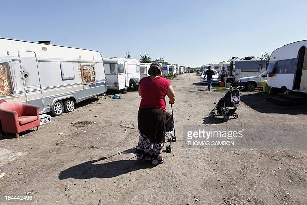 A woman belonging to the Roma community walks in a camp on September 1st 2010 in TrielsurSeine Paris suburb France said on August 31 2010 it will...