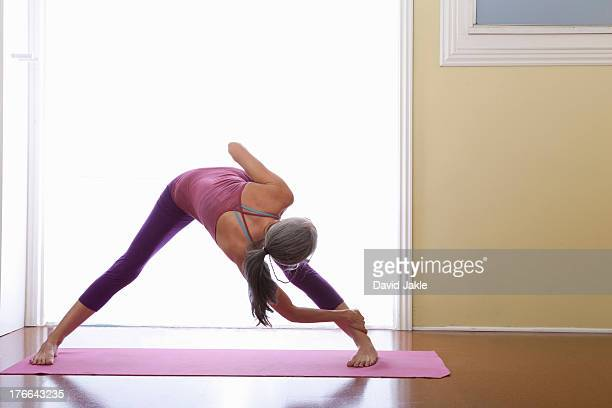 woman bending forwards and stretching legs - older woman bending over stock pictures, royalty-free photos & images
