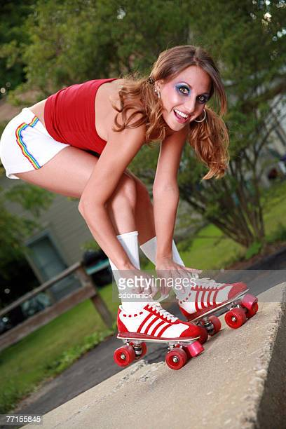 Woman bending over to tie her skate