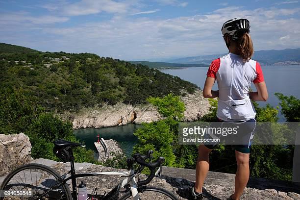 Woman bicycling on Island of Krk, Croatia