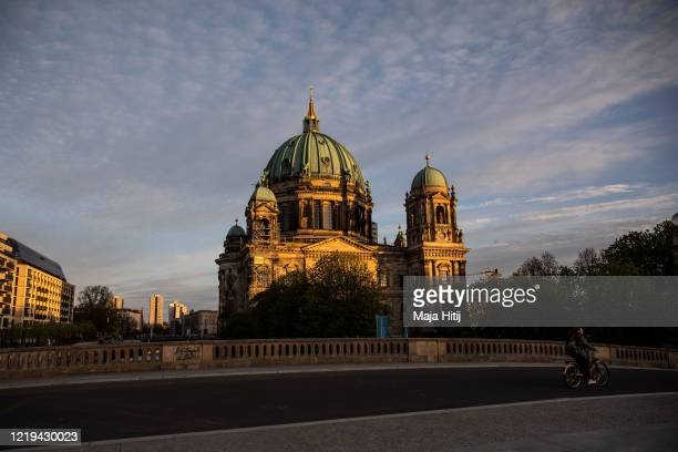 Woman bikes near Museumsinsel near Berliner Dom during the coronavirus pandemic on April 17 in Berlin, Germany. As the rate of new infections...