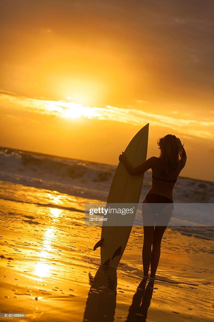 Woman Bikini Surfer & Surfboard Sunset Beach : Stock Photo