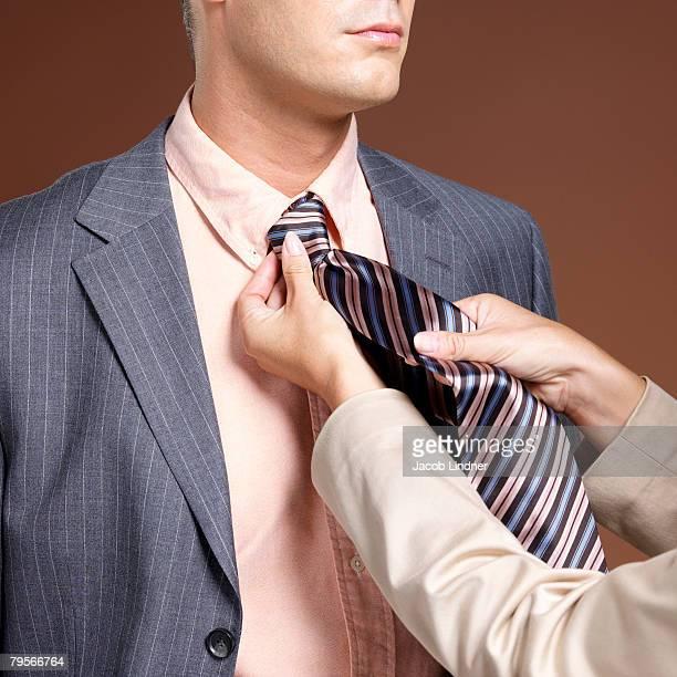 woman binding businessman's tie - frau gefesselt stock-fotos und bilder