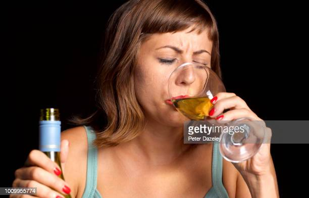 woman binge drinking on her own - drunk stock pictures, royalty-free photos & images