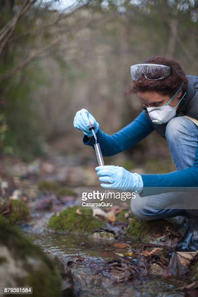 Woman Biological Researcher Taking a Water Sample