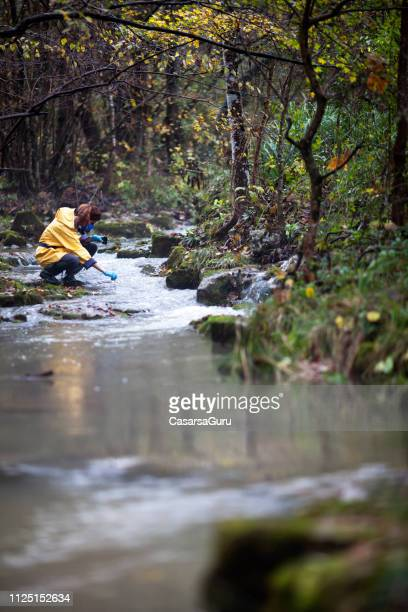 woman biologists checking water purity - ecosystem stock pictures, royalty-free photos & images