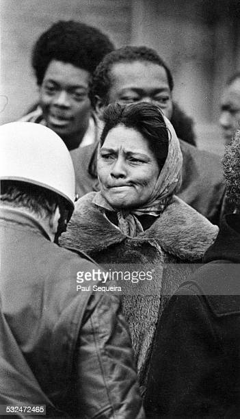 A woman bites her lips while watching an eviction Chicago Illinois 1970 Helmeted police stand guard The eviction resulted from racist real estate...