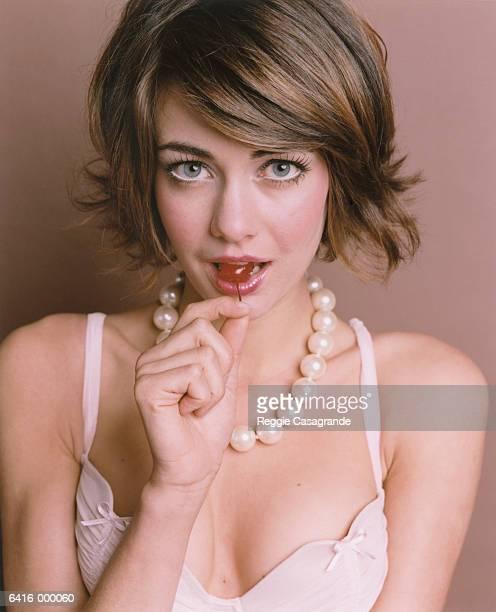 Woman Biting Cherry