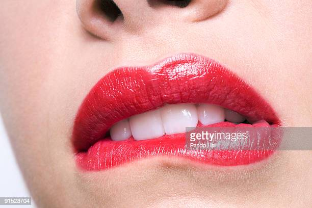 Woman biting her lip, close-up