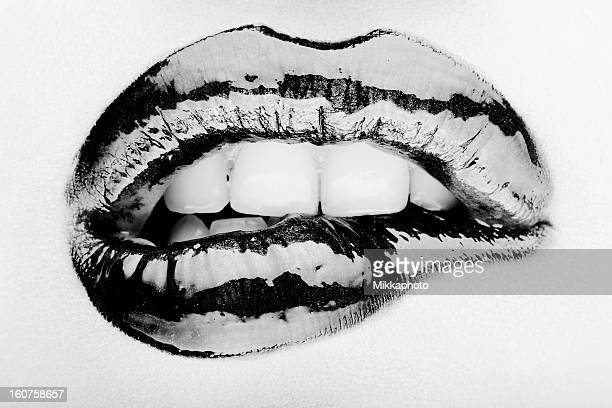woman biting her lip - erotiek stockfoto's en -beelden