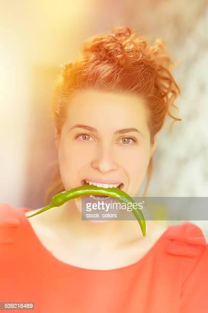 woman biting jalapeno