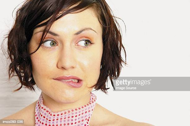 woman biting lip - blame stock pictures, royalty-free photos & images