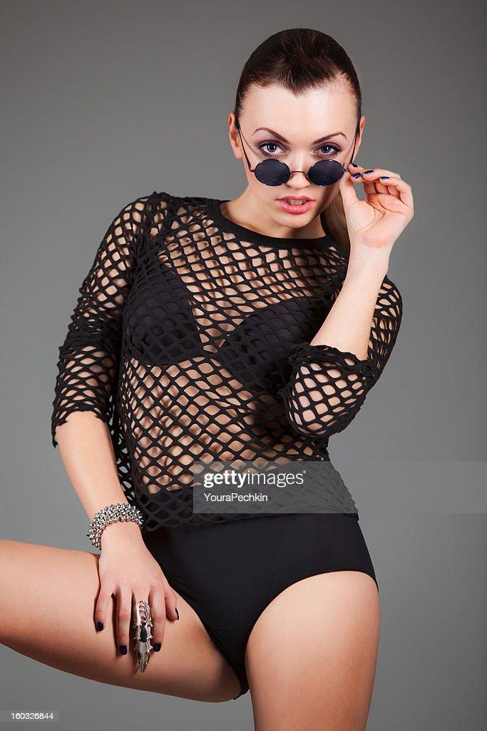 Woman black sexy clothes : Stock Photo
