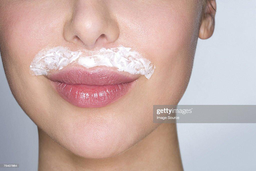 Woman bleaching facial hair : Stock Photo