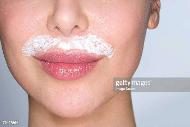 woman bleaching facial hair - facial hair stock pictures, royalty-free photos & images