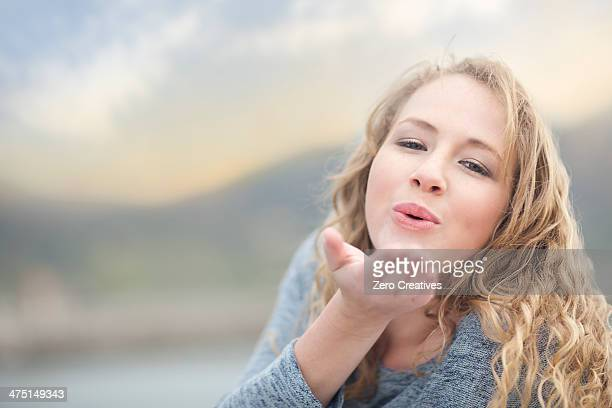 Woman blowing a kiss, Hout Bay, Cape Town, South Africa
