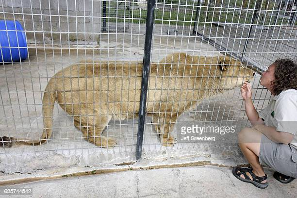 A woman blowing a kiss to Lucky the lion